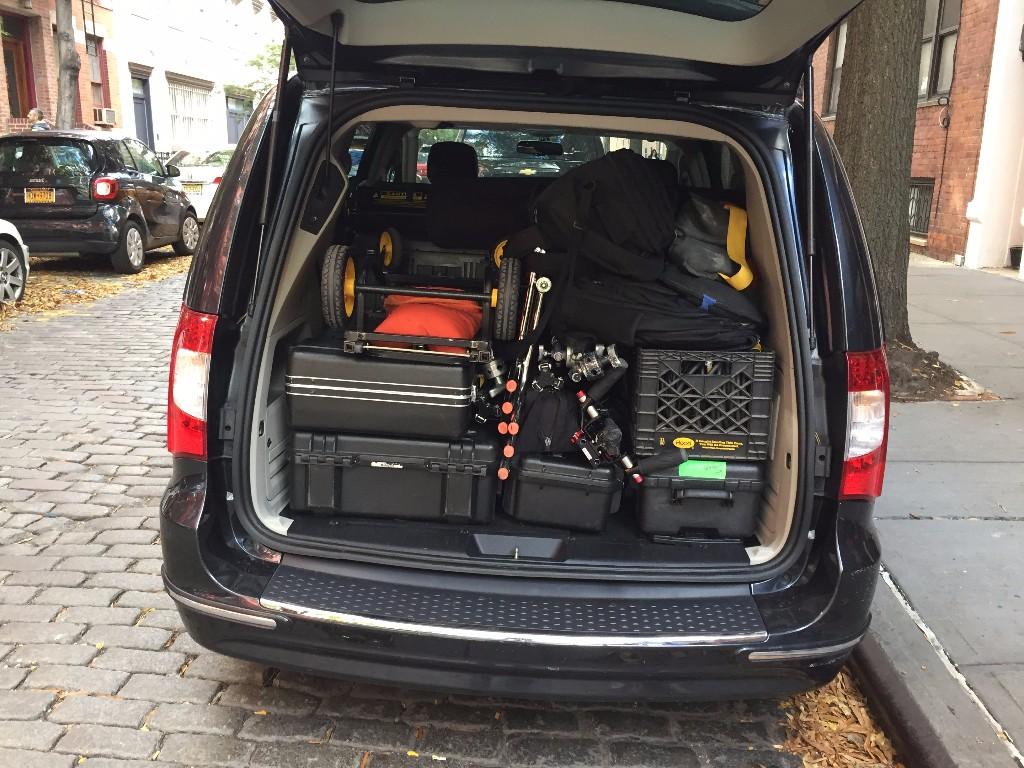 Production crew loading trunk including Canon C300 Mark II camera